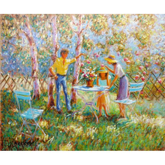 Repas en famille dans le jardin en fleurs